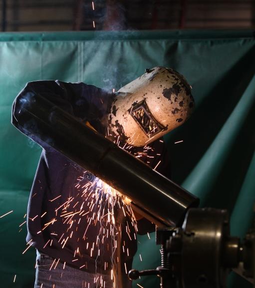 Man with welding helmet